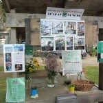 Farm stand with information and pictures concerning the cattle/farm.