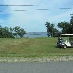 Golf cart at the golf course in scenic Rockport bay looming in the distance.