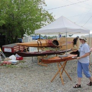 Lady setting up boat show on the waterfront.