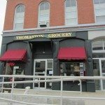 Red awnings adorn this grocery store on main street.