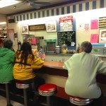 People sitting at the Ice Cream Counter at Rexall Drug