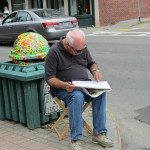 Sketch artist on Main Street in Rockland, Maine during the Maine Boats, Homes and Harbors Show