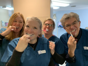 Camden, ME dental team learns how to brush their teeth.
