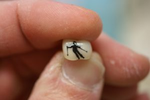 Man Skiing Tooth Tattoo